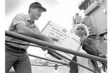 Petty Officer 2nd Class Robert Fabrizio and Sister Lily Bumdum of the Missionary Sisters of Charity help load relief supplies onto the USS Fife at Yokosuka Naval Base in November, 1988.