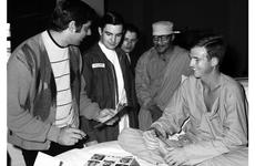 Joe Namath signs an autograph for Pfc. Henry Lock at the U.S. Army Hospital on Camp Oji, Japan, in January, 1969.