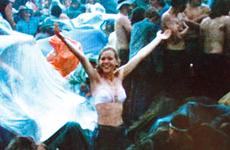 David Allen's 19-year-old sister, Kathy, frolics in the rain at Woodstock, catching the attention of the film crew.