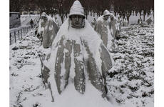 Snow covering the statues at the Korean War Veterans Memorial in Washington, D.C., during a February, 2015 storm serves as a reminder of the hardships endured by troops who fought in the conflict.