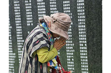 A woman prays for loved ones lost in the Battle of Okinawa during the annual Irei no Hi ceremony at Peace Memorial Park in Okinawa, Japan, June 23, 2019.