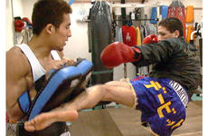 David Archuleta, right, mixes it up with sparing partner Masaaki Kato.