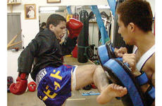 David Archuleta, left, mixes it up with sparring partner Masaaki Kato.