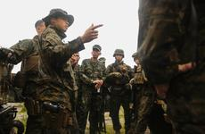 1st. Lt. Bridgett Soares, military police platoon commander with Combat Logistics Battalion 31, 31st Marine Expeditionary Unit, briefs U.S. Marines and their Philippine counterparts before improvised explosive device detection and convoy defense tactics training at Colonel Ernesto Ravina Air Base, Philippines, Oct. 7, 2016.