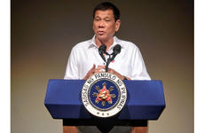 Philippine President Rodrigo Duterte speaks to the Philippine Economic Forum in Tokyo, Wednesday, Oct. 26, 2016. Duterte said he wants to end his nation's reliance on foreign military assistance.