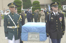 The remains of a U.S. soldier are carried to a waiting hearse Thursday on Knight Field at Yongsan Garrison.