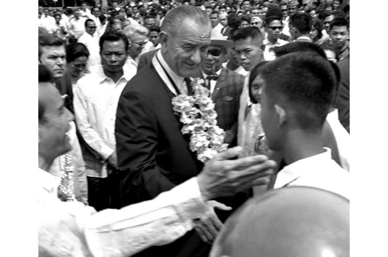 President Johnson mingles with the crowd during the Manila Summit.