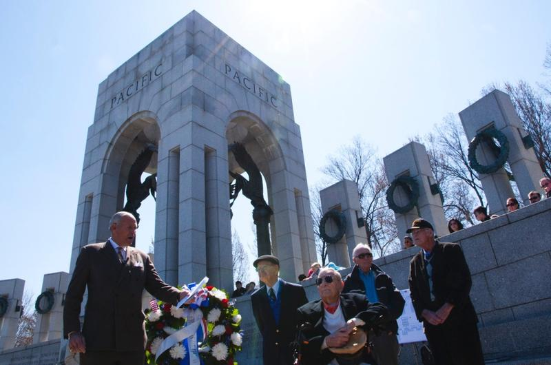 Josiah Bunting III, chairman of the Friends of the National WWII Memorial, honors veterans who fought in the Battle of Okinawa on April 1, 2015.
