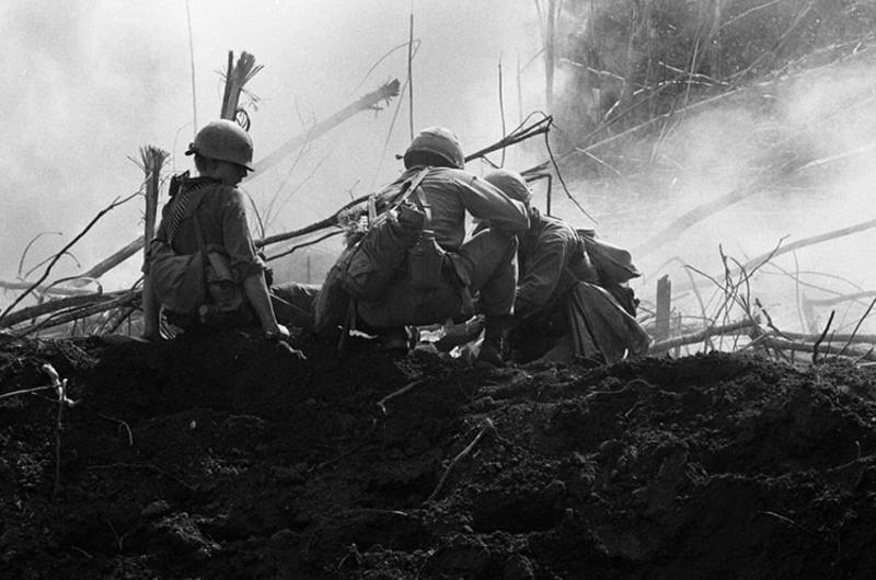 Infantrymen, of the 2nd Battalion, 35th Infantry bandage a wounded soldier after an American-fired mortar round fell short and exploded in the midst of the company.