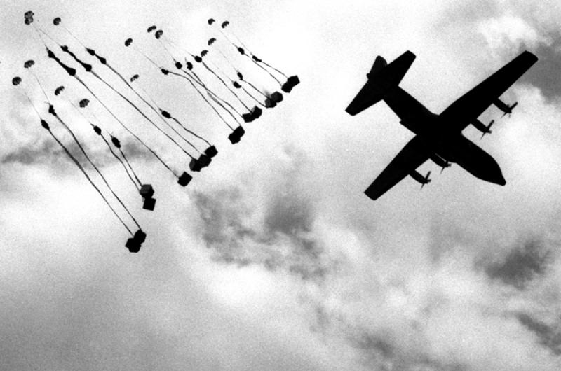 An Air Force C-130 Hercules drops supplies to U.S. troops attempting to encircle a suspected Viet Cong headquarters during Operation Junction City in Vietnam in February, 1967.