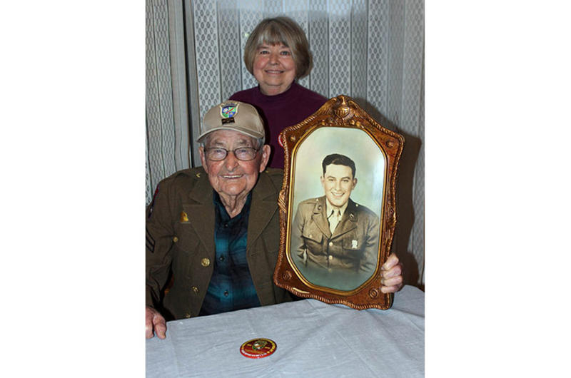 James Richardson, 99, a member of the famed Merrill's Marauders in Burma during World War II, poses with his daughter, Judy Robinson, in February 2020.