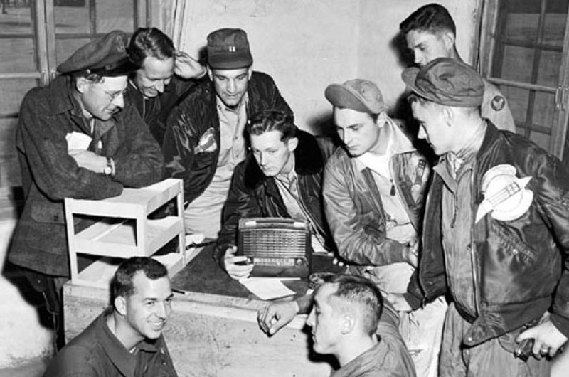 In Korea, F-86 Sabre pilots and other personnel of the 4th Fighter-Interceptor Wing listen to election returns over Armed Forces Radio Service in November 1952.