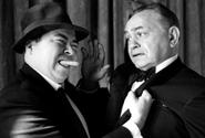Movie tough guy Edward G. Robinson pretends to cower at the rough treatment being meted out by Stars and Stripes' legendary columnist, Al Ricketts.